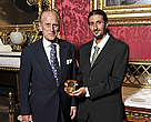 Ofir Drori, founder of LAGA, receives a medal from HRH the Duke of Edinburgh.