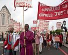 Climate Justice march with Anglican Church of Southern African in Cape Town, headed by the Archbishop of Cape Town, Thabo Cecil Makgoba (in front)