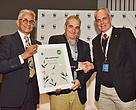 Andrew Zaloumis receives the Living Planet Award from WWF South Africa Chairman Valli Moosa, left, and Dr Morne du Plessis, WWF-SA CEO, right.
