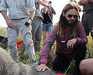 Jared Leto helps to tag and collar a white rhino.