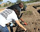 Joeline Barnato and Mbeko Balfour planting seeds at a school in Saldanha Bay