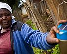 Farmer Margaret Mundia shows her solar-powered torch.