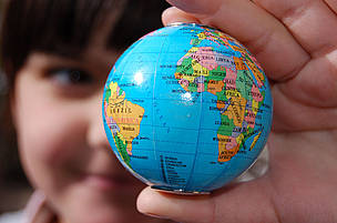 Map of the world in a girl's hand